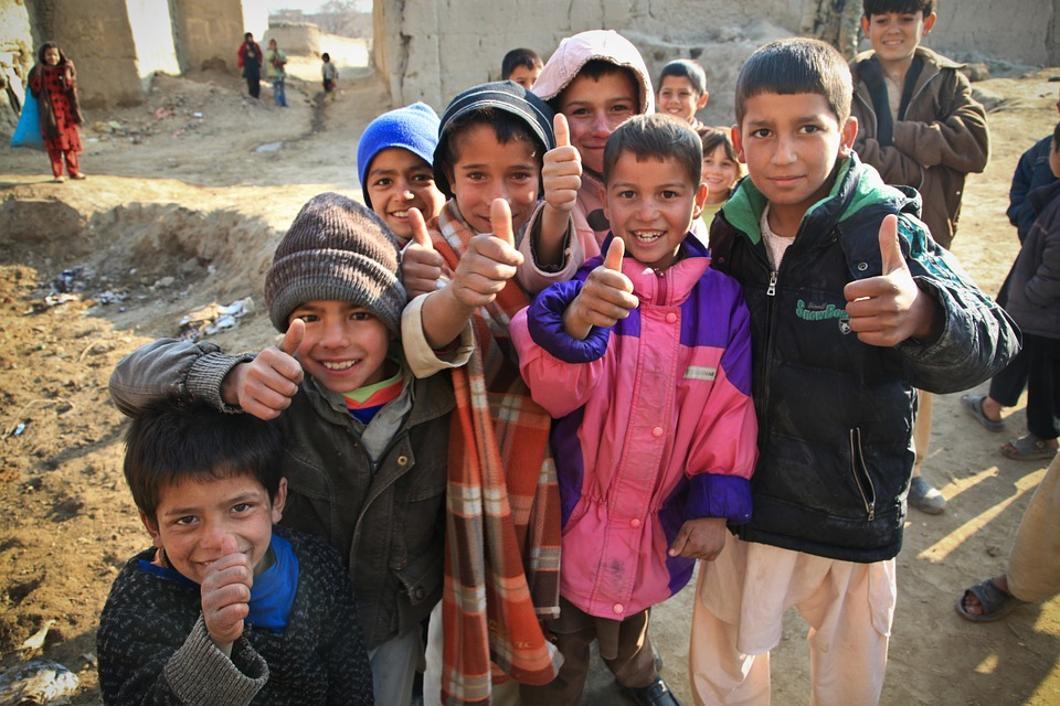 A group of children posing for a photo Description automatically generated with medium confidence